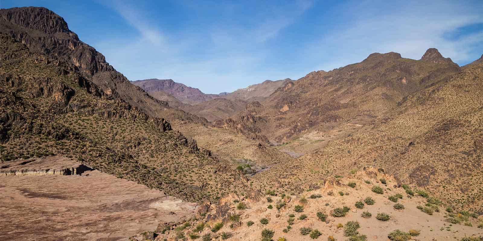 Scenic mountain range of Jebel Sahro looking down to valley road