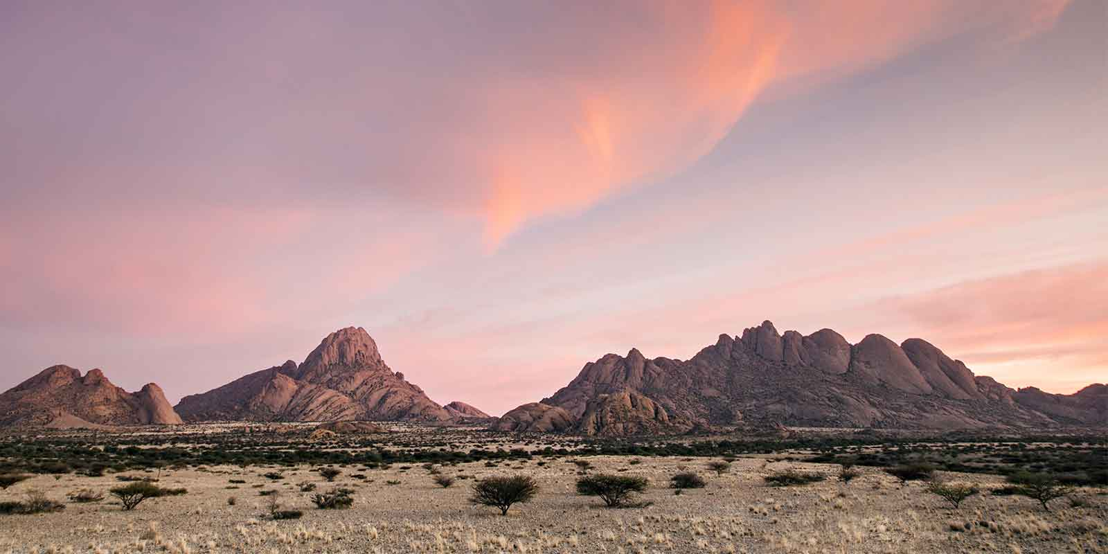 Spitzkoppe at sunrise with red sky