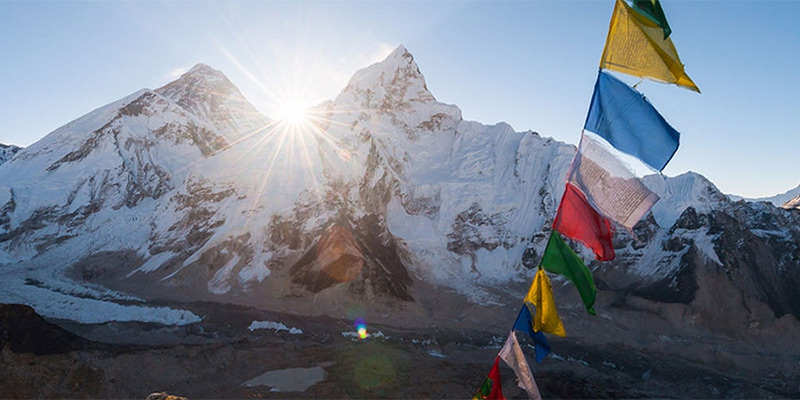 Prayer flags against a backdrop of Himalayan peaks
