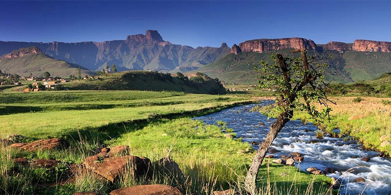 South African river valley with mountain ridge in background.