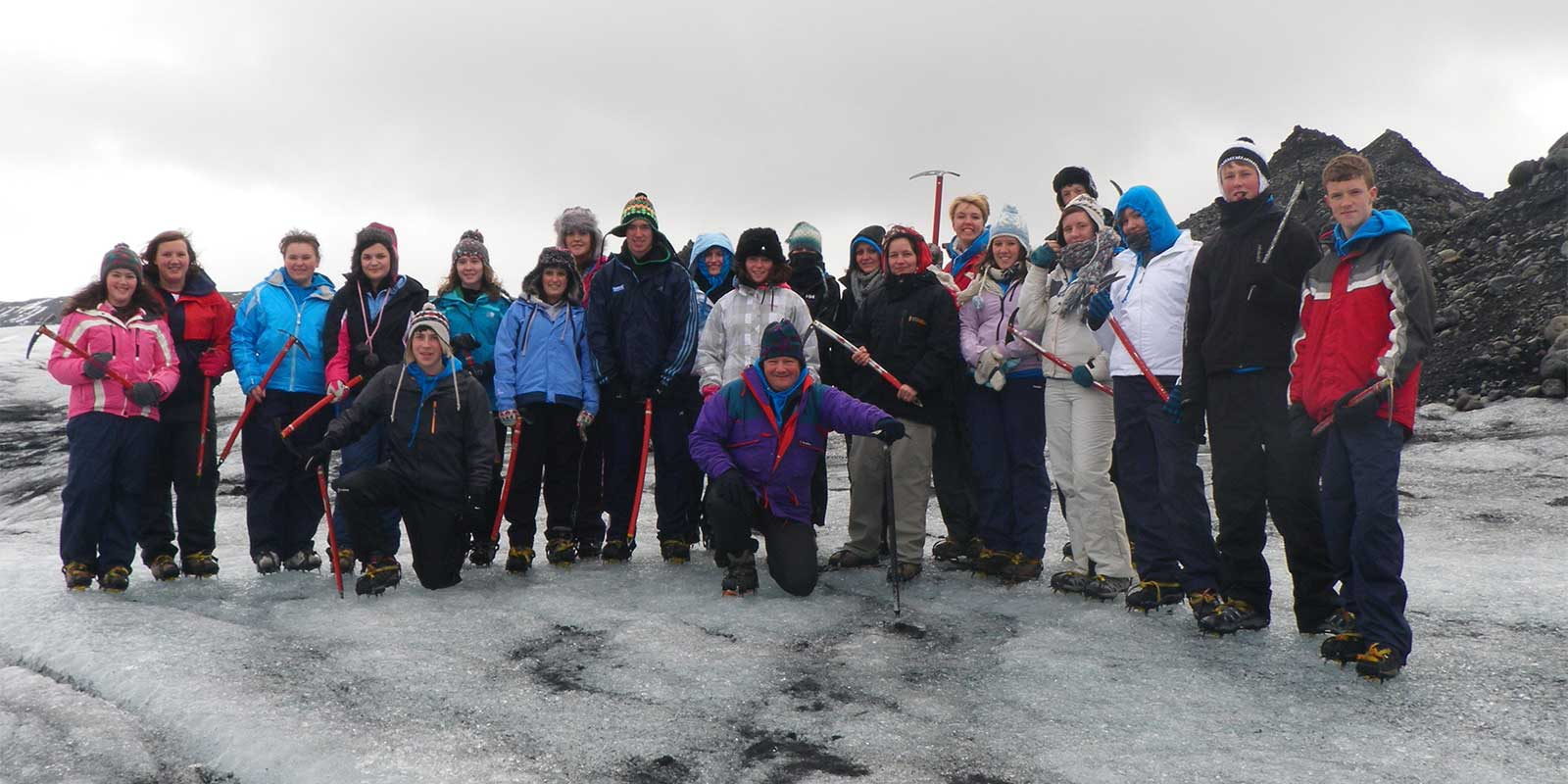 School group with ice picks after glacier trekking