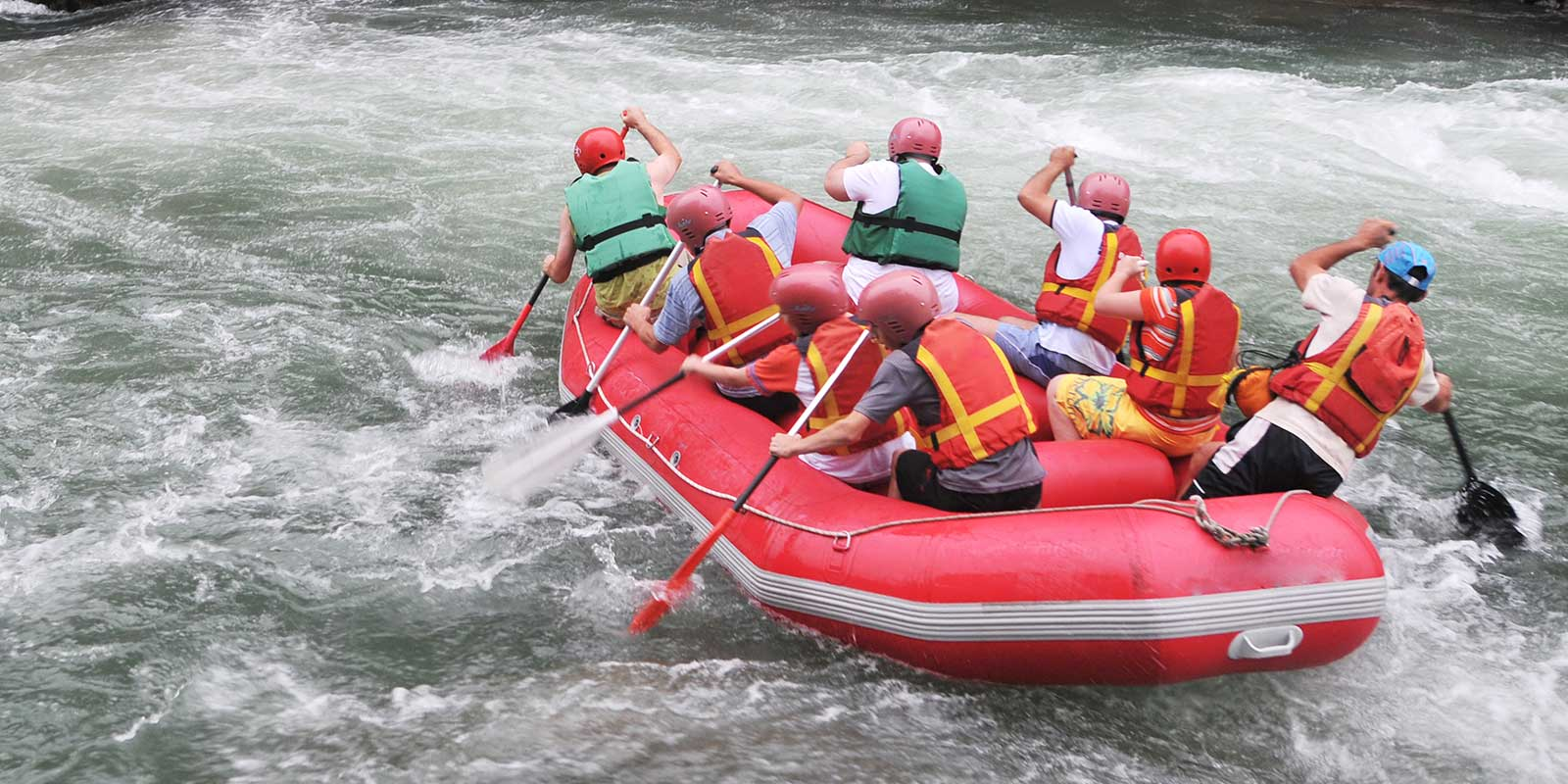 Group rafting in rapids in the river