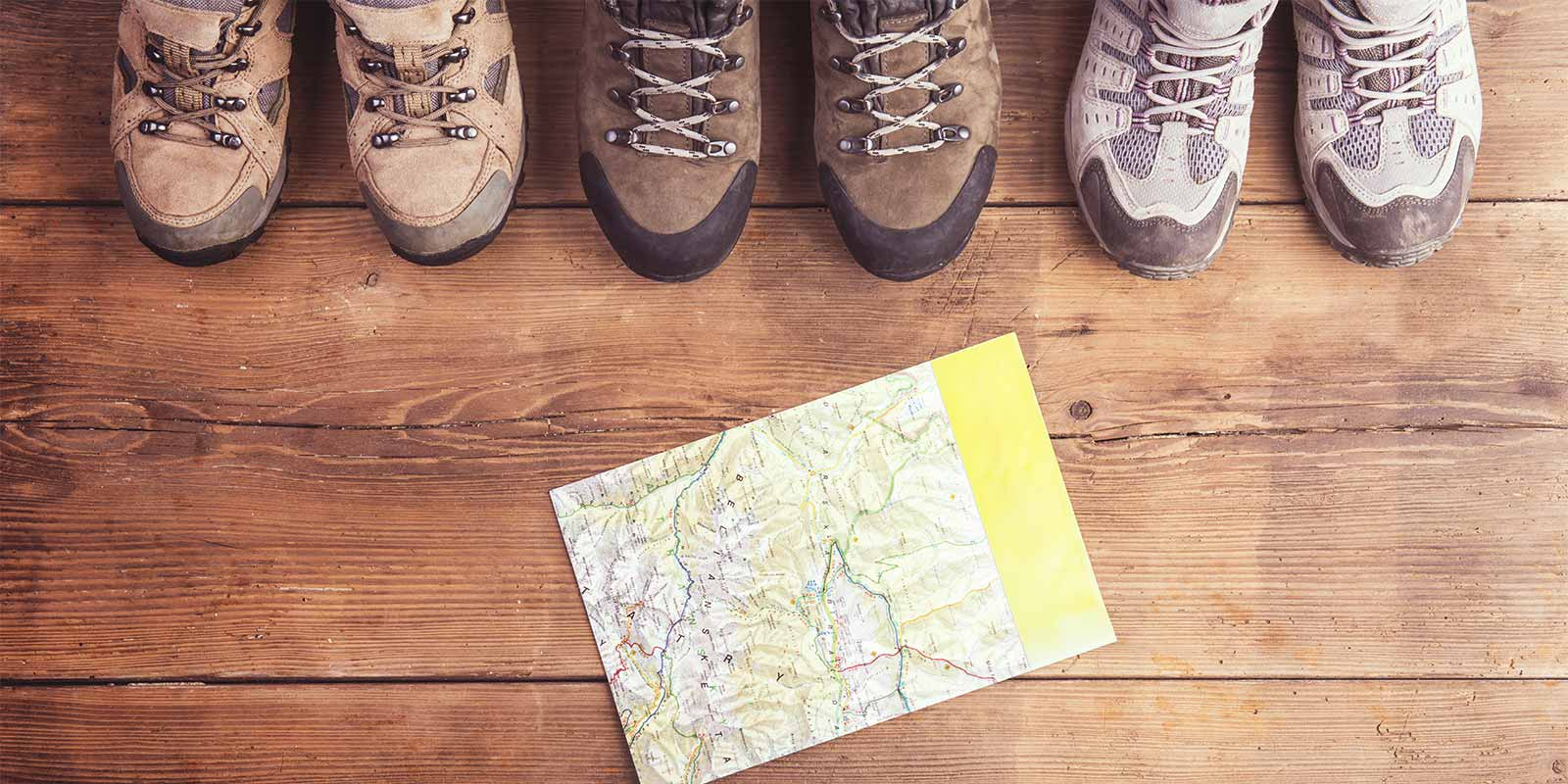 Aerial view of hiking boots and a walking map