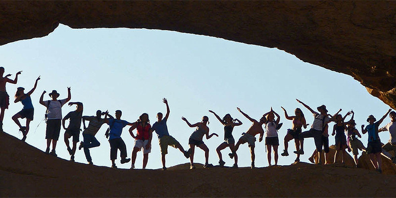Student group poses at Spitzkoppe Natural Arch