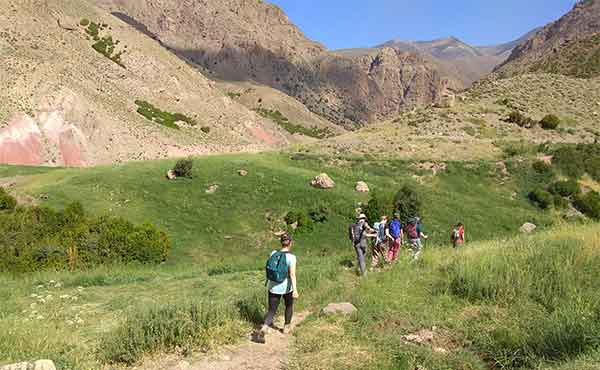 School group trekking in Ait Bouguemez Valley in Atlas Mountains of Morocco
