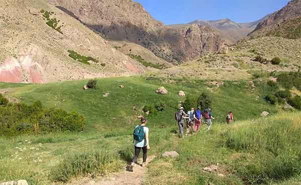 School group trekking in Ait Bouguemez Valley in Atlas Mountains of Morocco