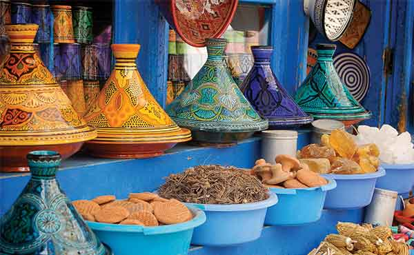 Colourful tagine pots and food in Marrakech market