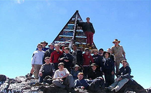 School group celebrating reaching the summit of Mount Toubkal