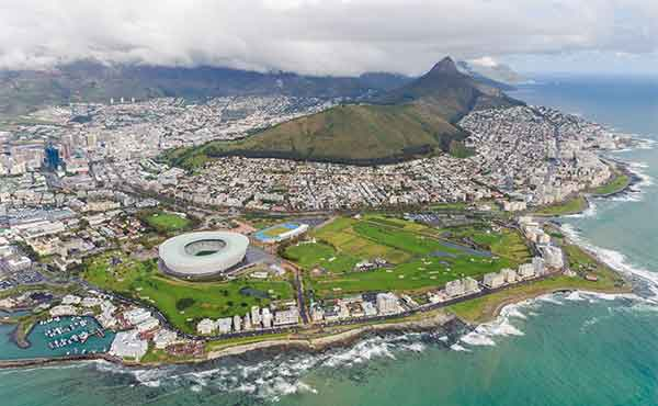 Aerial view of Cape Town with Table Mountain, stadium and rocky coastline