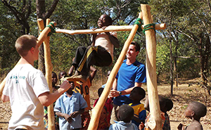 Zambian school children trying out climbing frame
