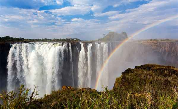 Cascading Victoria Falls with rainbow
