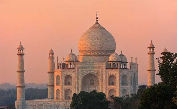 The Taj Mahal at sunset with a red hue