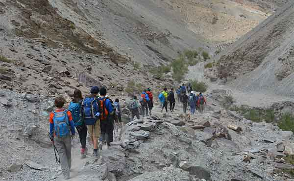 School group hiking in the Markha Valley in the Indian Himalayas