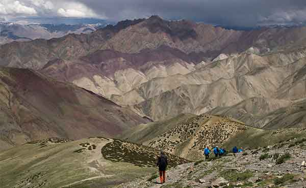 Trekkers walking down from Ganda la pass in Markha Valley