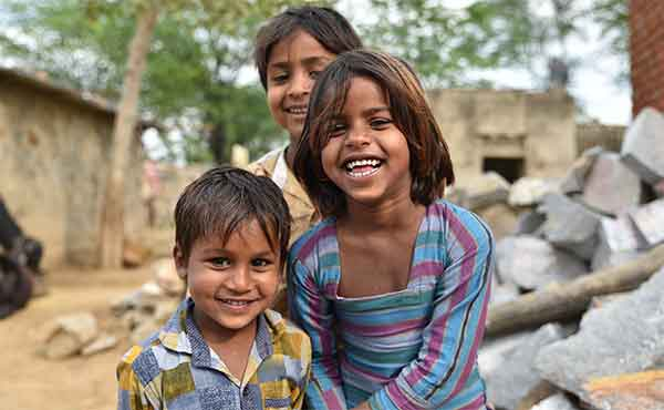 Smiling young children in a village in India