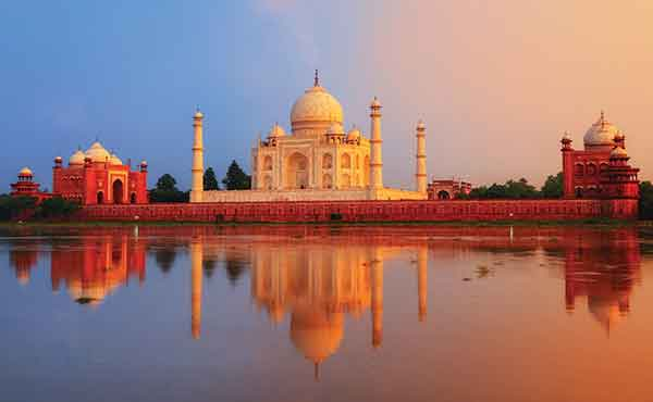 View of Taj Mahal with reflection and red hue