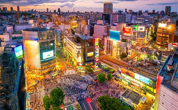 Aerial view at night of Shibuya Crossing in Tokyo
