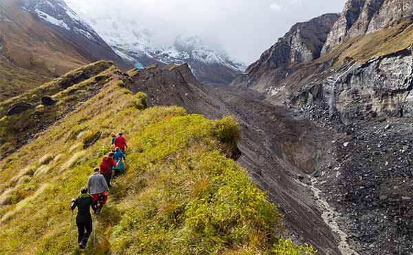 Group trekking on Himalayan mountain ridge