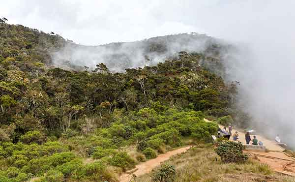 Group at World's End wtih mist rising over Horton Plains