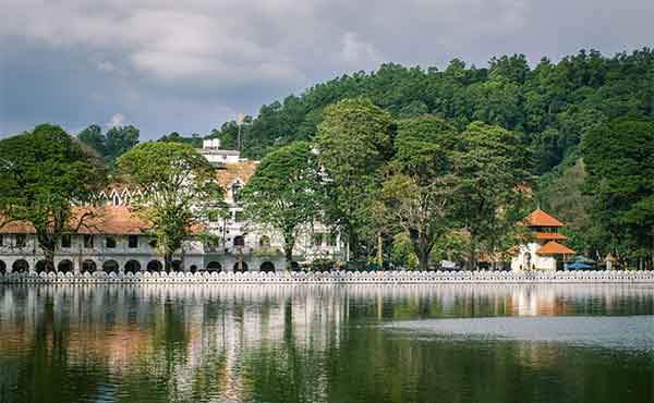 Royal Palace complex housing the Temple of the Tooth with Kandy Lake in foreground