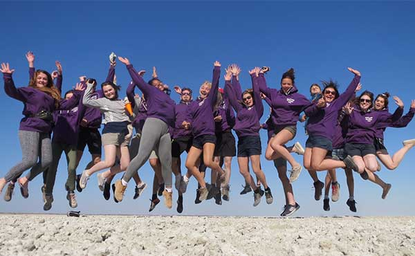 Group of students jumping in the air in Namibia