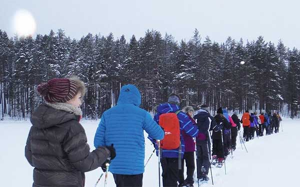 School group cross-country skiing in Finland