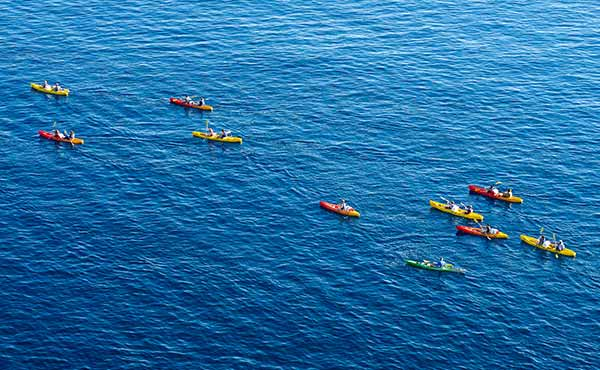 Group of kayakers in the Adriatic sea around the coast of Dubrovnik