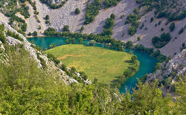 Aerial view of winding Krupa River Canyon in Velebit Mountains