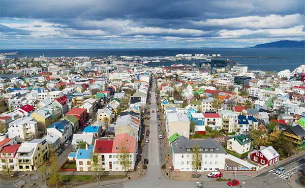 Aerial view of Reykjavik with colourful houses and harbour in the distance