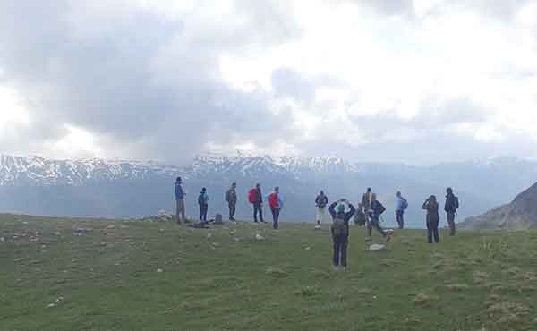 Group of people hiking on mountain in Mavrovo National Park Macedonia
