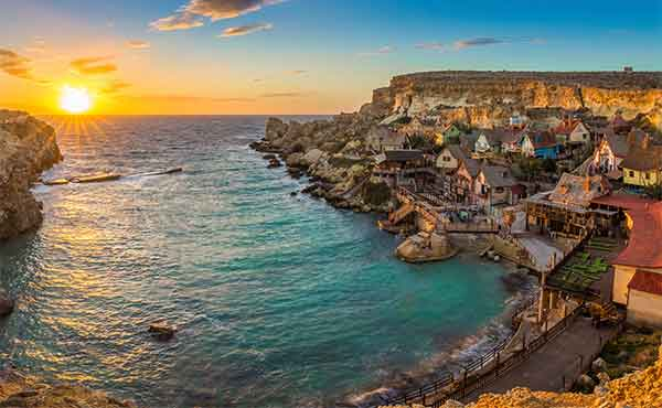 Popeye Village and Anchor Bay on the island of Malta at sunset