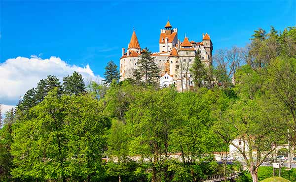 Bran Castle perched atop a hill in the spring