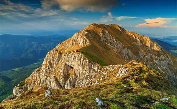 Rocky ridges of Piatra Craiului mountains in the Carpathians at sunset