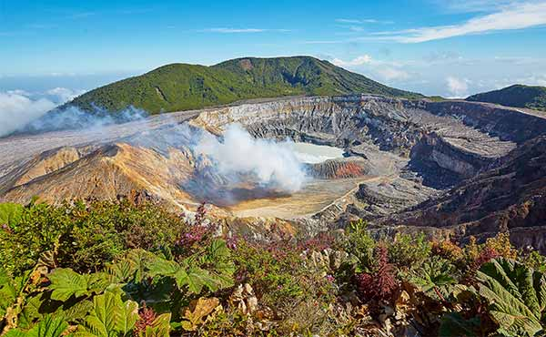 Smoking crater of Poas Volcano and surrounding vegetation
