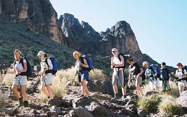 Group of students mountain trekking in Morocco